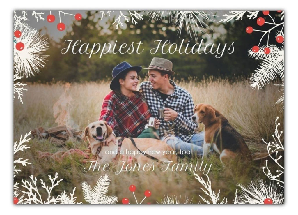 Card says Happiest Holidays with photo of couple and 2 dogs sitting in field