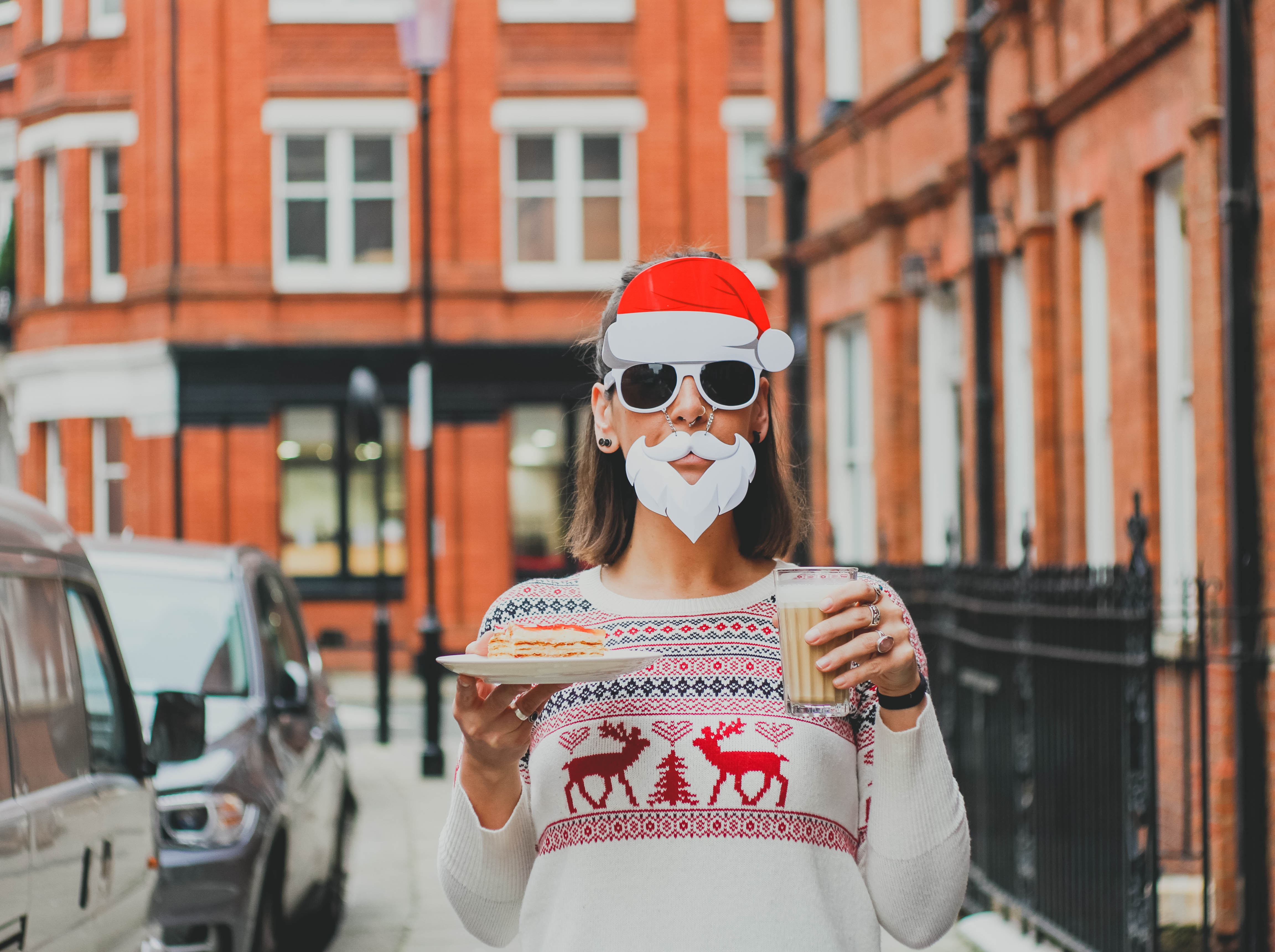 Woman in a Christmas sweater and Santa hat