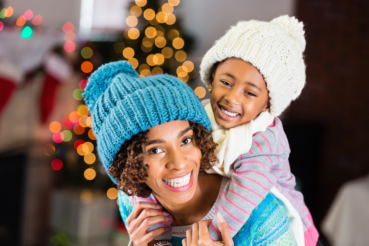 Beautiful African American mother and daughter on Christmas day